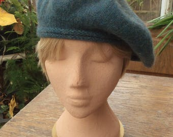 A ladies beret in a soft teal coloured pure new wool