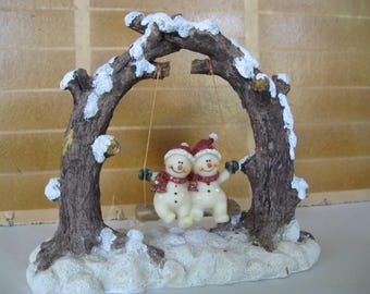 Resin swinging snowmen figurine used