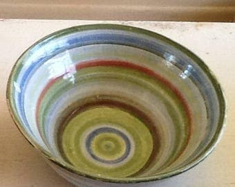 Party bowl, so pretty!   Handthrown, glazed, ceramic pottery bowl with green, blue, red, white rings.  Liven up your party table.