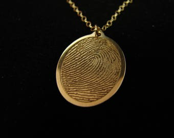 Solid 14k gold fingerprint necklace.