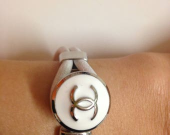 Authentic designer logo button repurposed into bracelet , handmade