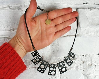 Upcycled inner tube statement necklace MOMBASA. Black perforated necklace. Vegan jewelry. Recycled bicycle. Original eco conscious design.