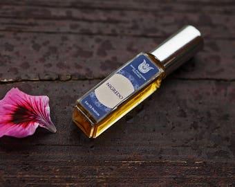 Nigredo - Natural eau de perfume,  woody-balsamic, with spikenard, frankincense, cognac, osmanthus,  agarwood, orris,   patchouli Flacon.