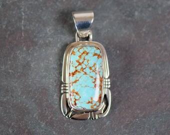 Navaho Artist Phillip Sanchez Sterling Silver Number Eight Turquoise Pendant