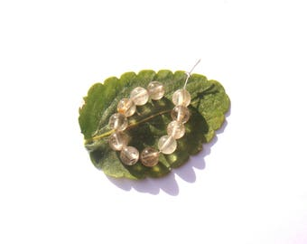 Golden rutilated quartz: 11 round beads 6 mm in diameter