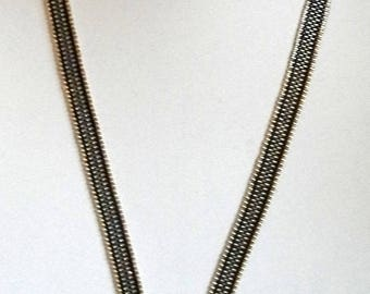 woven necklace silver, black and haematic