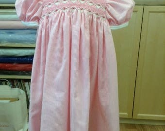 Hand Smocked Pink and White striped girl's dress with basket of flowers design