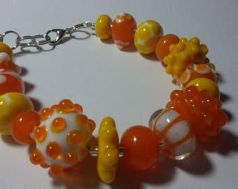 Lampwork bead bracelet by Megan yellow, tangerine, & white