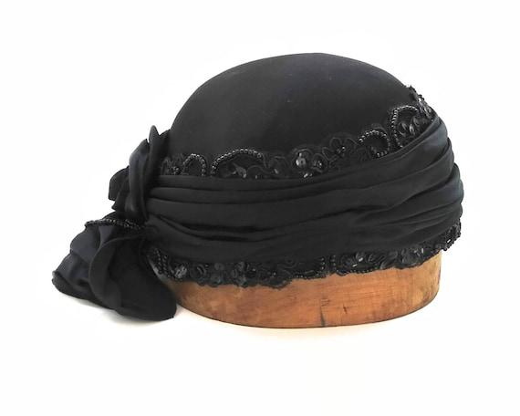 Black beaded cloche hat, flapper hat, satin fabric, beaded & sequinned Guipure lace, fabric rose, Elizabeth R, Australia, 22.5 ins / 57 cm