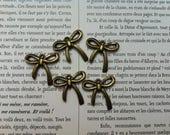 Lot de 5 Breloques bronze noeuds