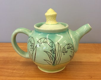 Handmade Teapot in Aqua and Lime with drawing of Lily-of-the-valley, stripes and carved spirals. MA33