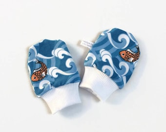 Blue baby scratch mitts with fish. Mittens with cuffs. Shower gift. Knit fabric with orange fish. No scratch mitts. Gold fish