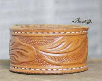 CUSTOM HANDSTAMPED tan leather cuff with stitching and design by mothercuffer