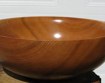 Cherry salad bowl. Finish  with oil  18 1/2 in in diameter by 6 7/8   in in height. Item 421-A