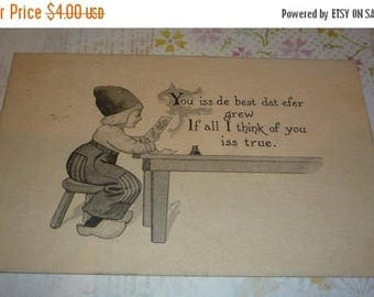 On Sale Dutch Boy Looking at Picture of a Girl Antique Postcard