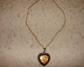 Animal Print Bronze Heart Pendant On A Soft Beige Suede Cord Necklace