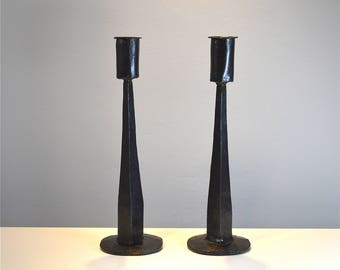 Pair of medieval style hand made wrought iron candlesticks aged metal candle stick