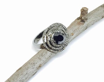 10% Pave Diamond ring set in sterling silver 925. Center stone is black diamond. Authentic natural diamonds.Carat wt- 2.10. Size-8