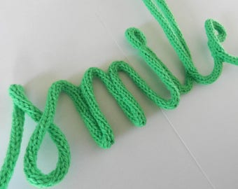 """Word """"smile"""" Knitting with wire"""