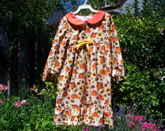 Pumpkin dress with peter pan collar and ruffle hem, 8 years