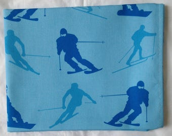 Mid blue skiing and snowboarding tea towel -  mid blue skiing and snowboarding kitchen towel  - in 100% cotton