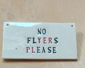 A sign for the front of house