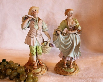"""Occupied Japan 10"""" Colonial Figurines of Boy and Girl Collecting Fruit - Bisque Porcelain"""