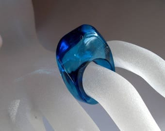 Transparent blue acrylic polyester resin ring