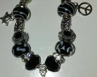 Black, White and Silver Bracelets with Charms