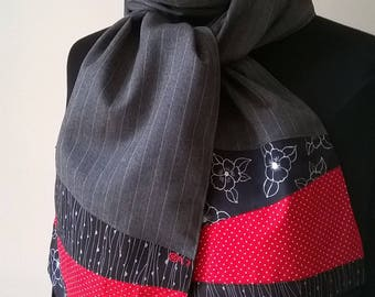 Gray Pinstripe fabric scarf and its black and Red ends.