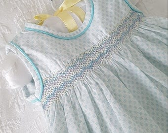 An adorable Hand Smocked Pale Blue and White baby dress  - Size 0-3 months, 3-6 months and size 1