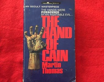 The HAND OF CAIN (Paperback Novel by Martin Thomas)