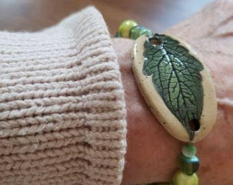 Shades of green in this ceramic leaf bracelet