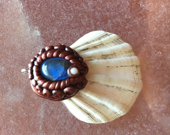 Laboradite with opal seashell pendant
