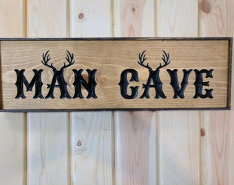 "Carved 25 inches ""MAN CAVE"" SIGN with Antlers"