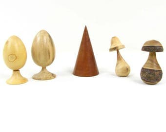 Decorative items made in various exotic woods and country. Egg, mushroom, cone