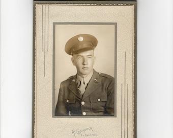 World war two soldier, vintage photo in folder