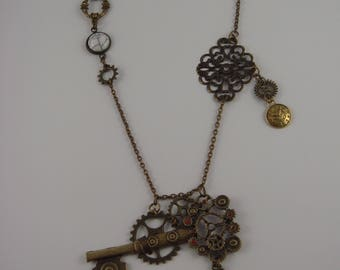 Steampunk necklace with gears, key, rabbit from Alice the Wonderland