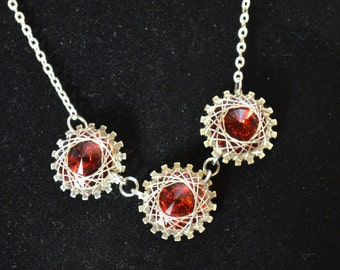 Necklace, sterling silver and ruby red swarovski crystal wire wrapped necklace