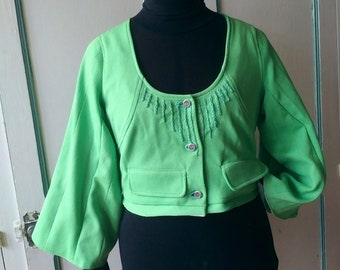 green jacket with embroideries