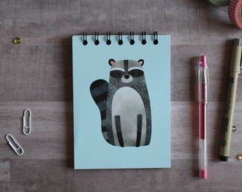 NOTEPAD. A6 Cute Raccoon Spiral Notepad. Soft 300 gsm Card Cover. 120 blank pages. Matte lamination pleasant to the touch.