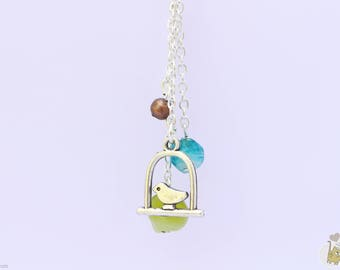 Silver necklace embellished with silver bird charms and beads