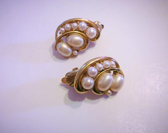 Vintage Trifari gold tone earrings with faux pearls, Trifari clip on 1990s pair of earrings.