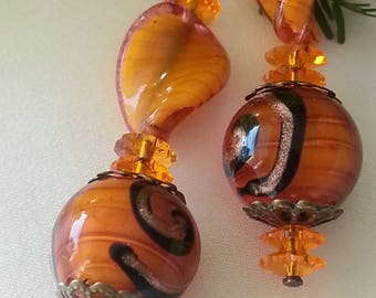 Swarovski crystal - and orange Murano glass earrings.