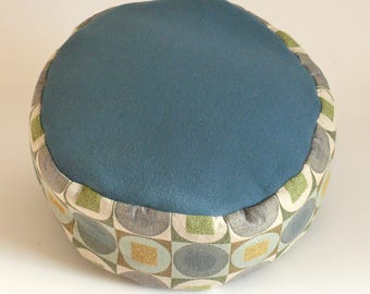 Unpleated meditation cushion with handle and hidden velcro closure. Mixed fiber fabrics. Organic buckwheat hull fill.