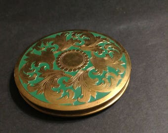 Rex Fifth Avenue round compact, aqua green and gold tone, swirled leaves design on front, push button open.