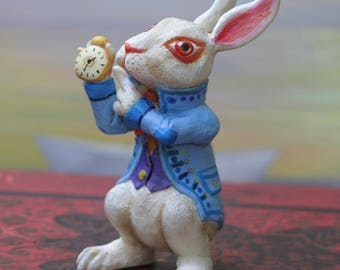 The White Rabbit.Lapin white figurine. Alice's Adventures in Wonderland. Follow the white rabbit. The adventures of Alice in Wonderland of