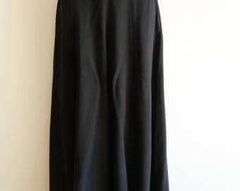 High waisted and wide legged silk black trousers by French designer