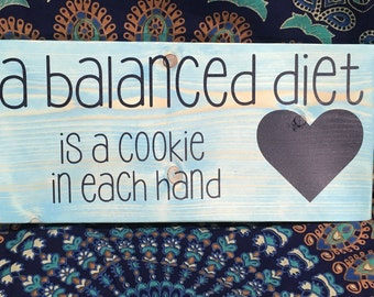 "Wood sign - ""A Balanced Diet -- Is a Cookie in Each hand"""