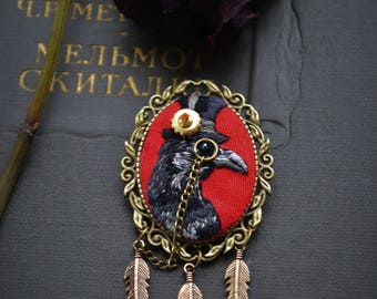 Brooch Raven with a monocle